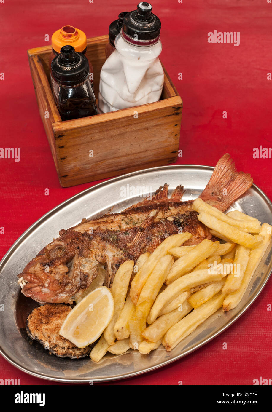 Grilled Red Roman fish as served at Kalky's restaurant in Kalk Bay, Cape Town. - Stock Image