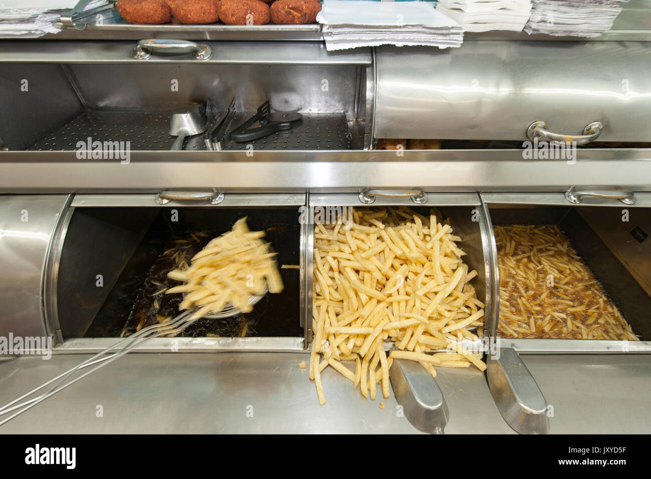 Frying chips in Lusitania Fisheries, Cape Town. - Stock Image
