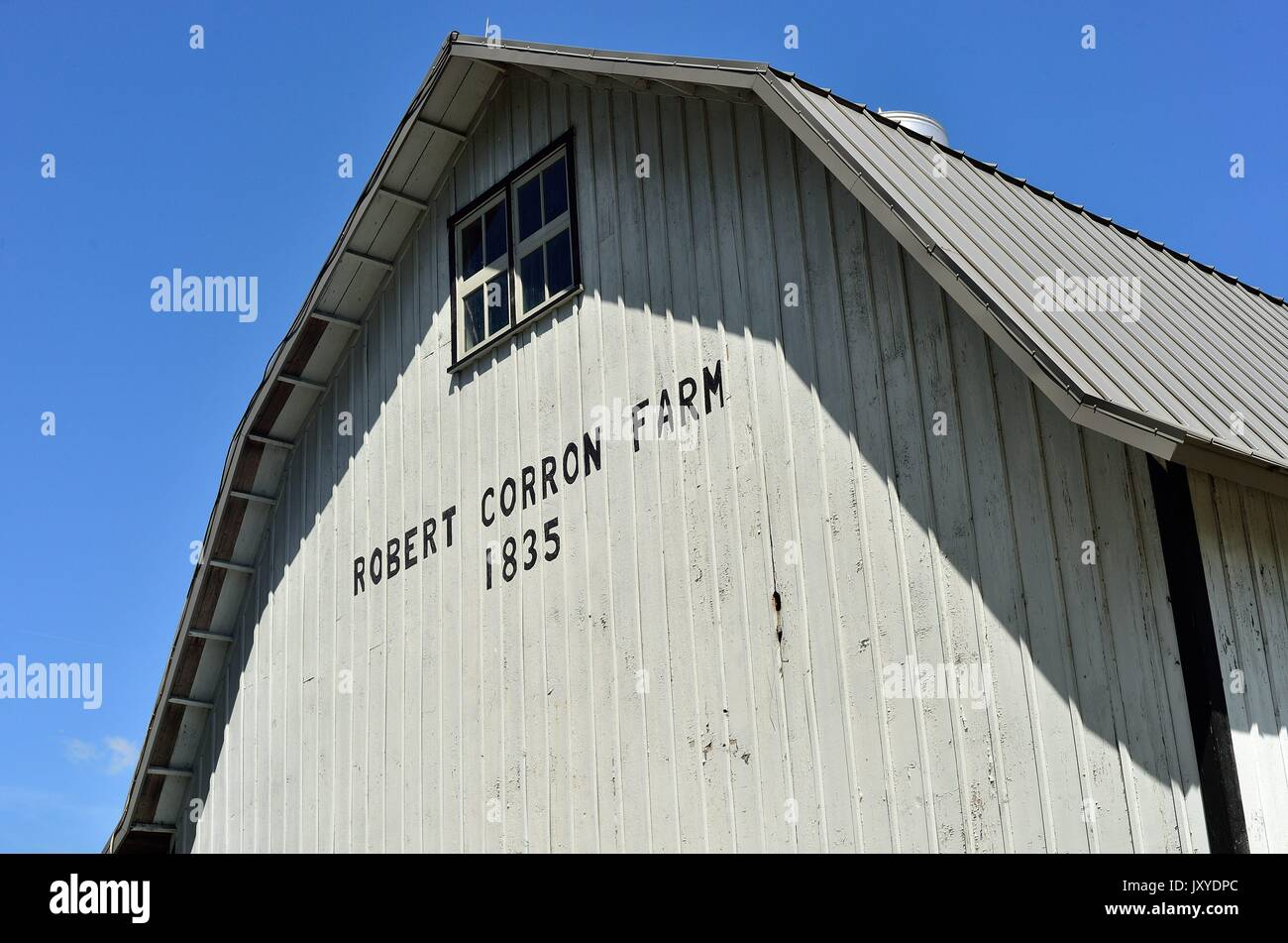 A link to the past and a farm's origins appears on the side of one of the spread's large storage barns. St. Charles, Illinois, USA. - Stock Image