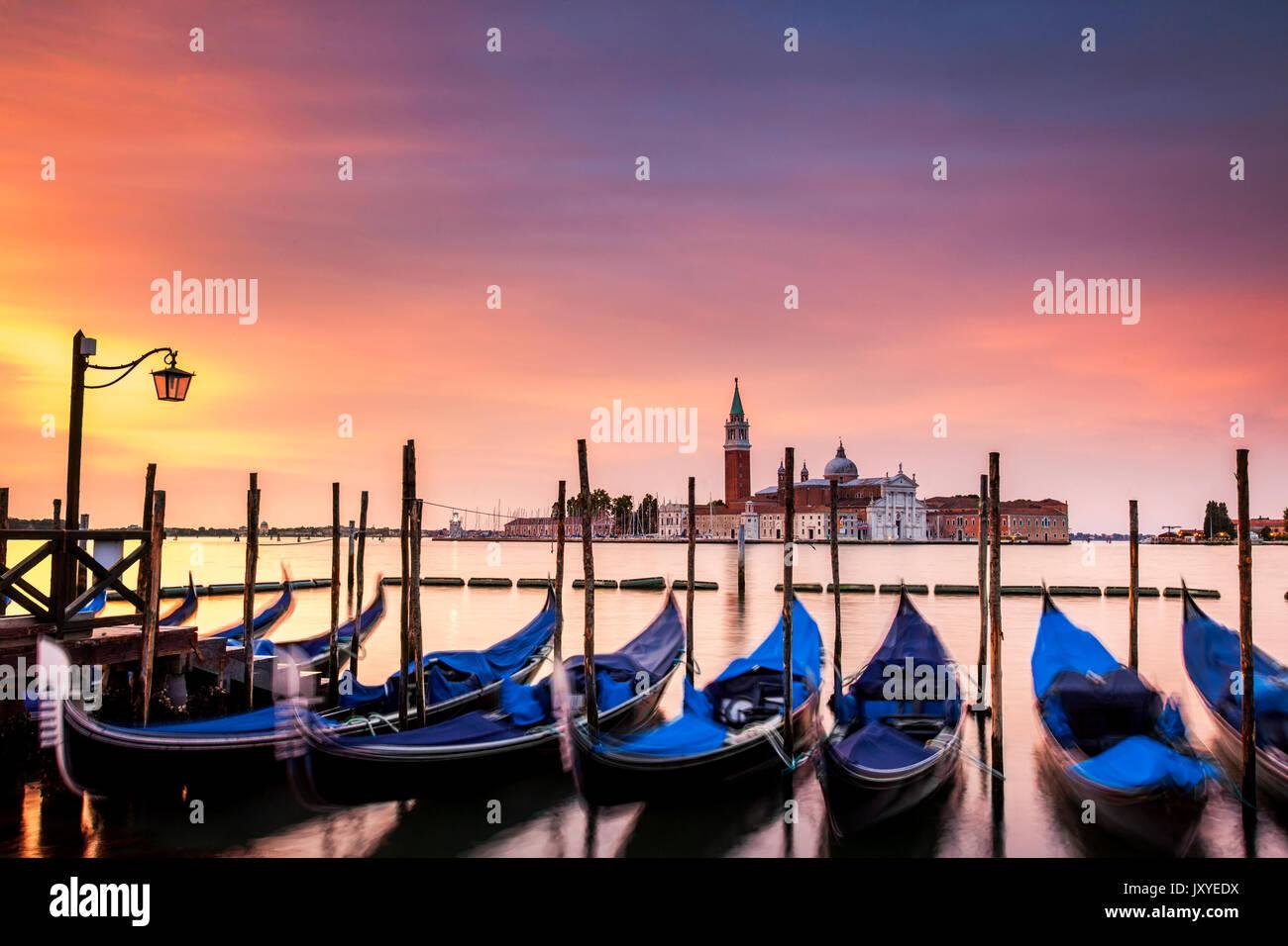 Vibrant dawn over the island of San Giorgio Maggiore seen from just off St. Mark's Square in Venice, Italy. - Stock Image