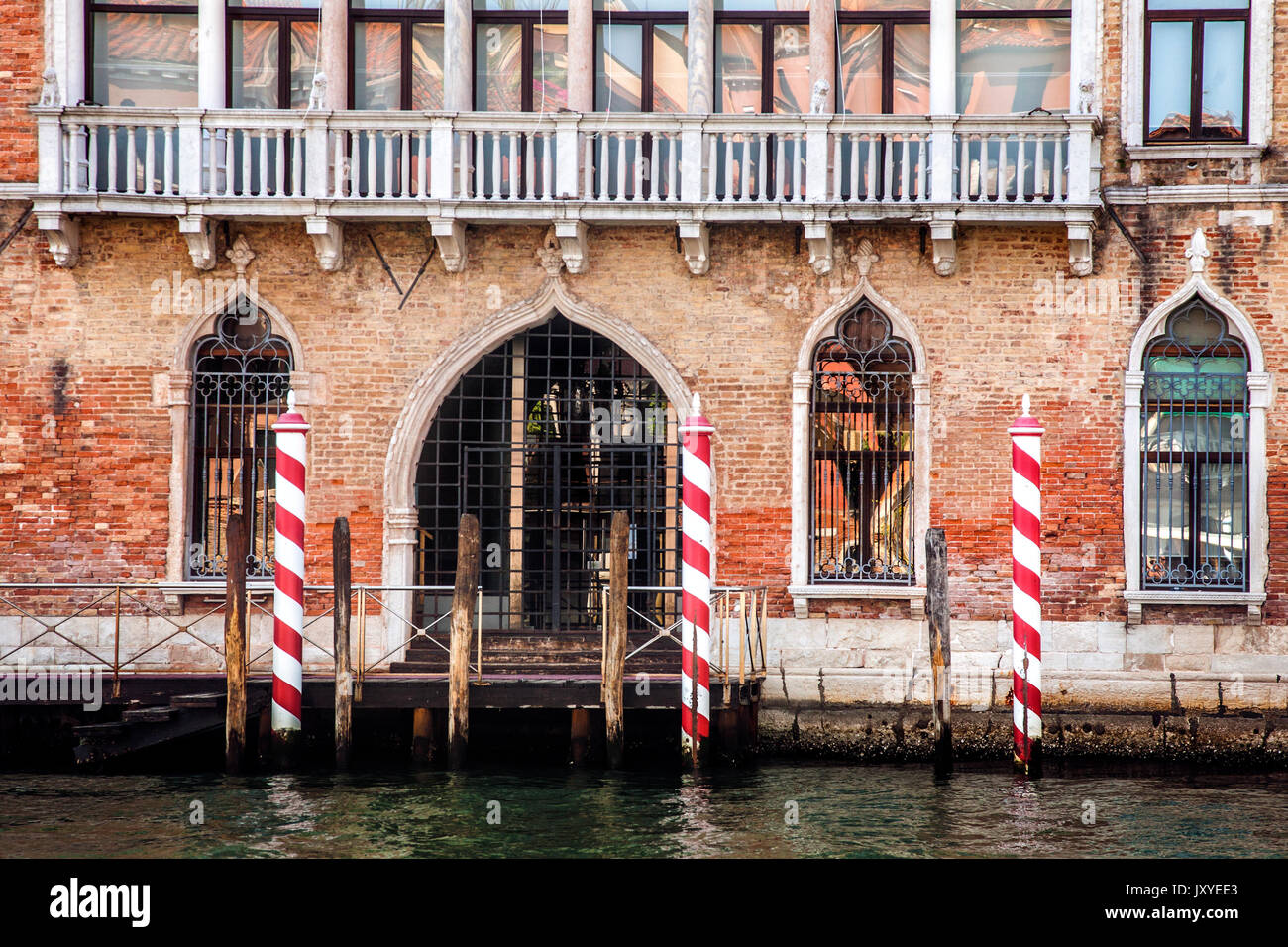 Entrance to a building just off the Grand Canal in Venice, Italy. - Stock Image