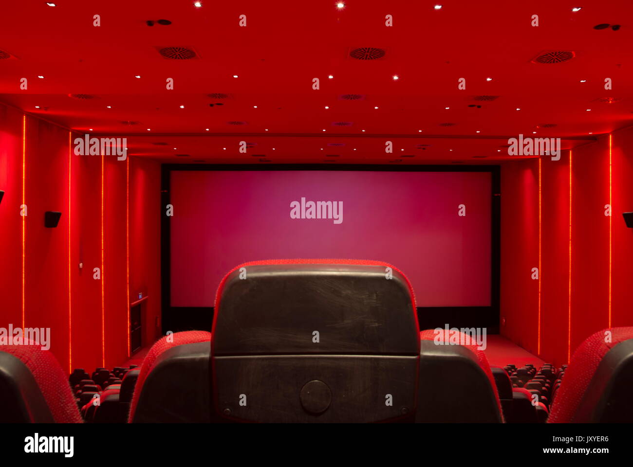Empty, red movie theater. Movie starts - Stock Image