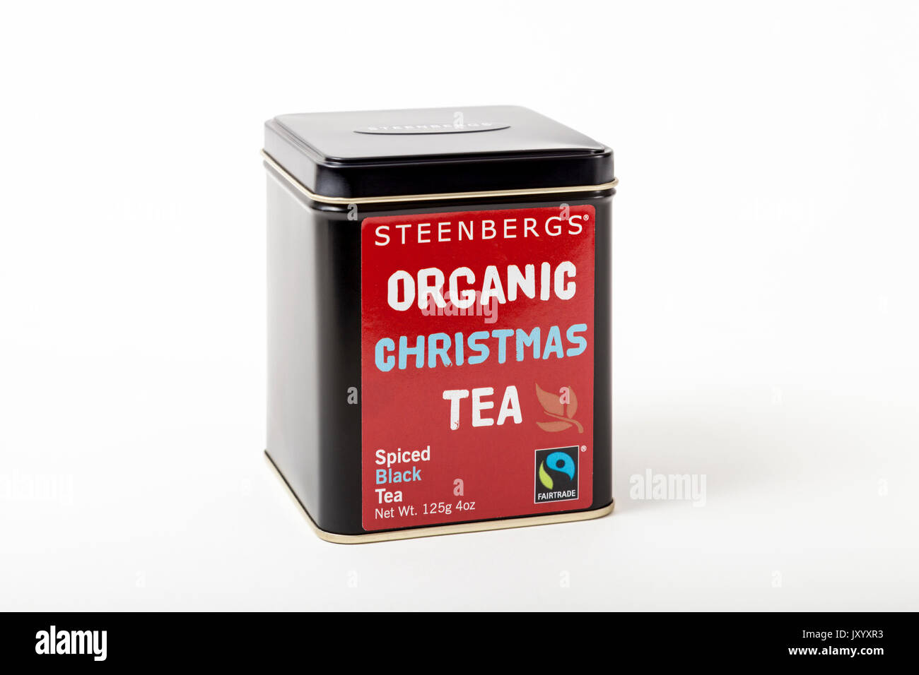 Fairtrade tea. A tea caddy of Steenberg's Organic Christmas Tea, a fairtrade product of spiced black tea. On a white background Stock Photo