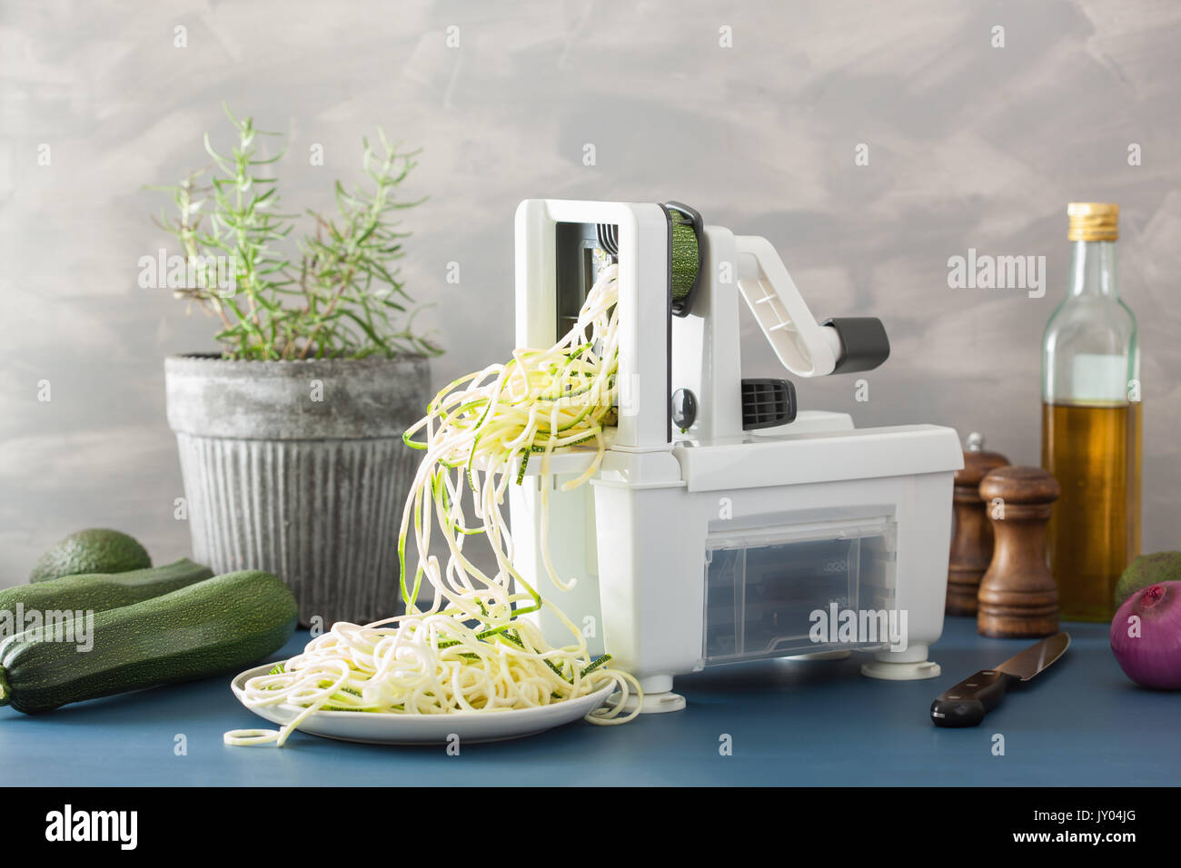 spiralizing courgette raw vegetable with spiralizer Stock Photo