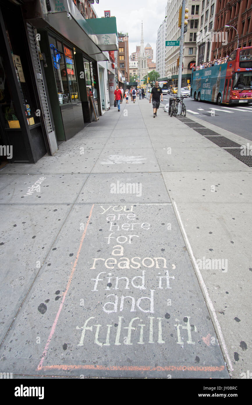 An inspirational message written in chalk on the sidewalk on Broadway and Astor PLace in Greenwich Village, New York City. - Stock Image