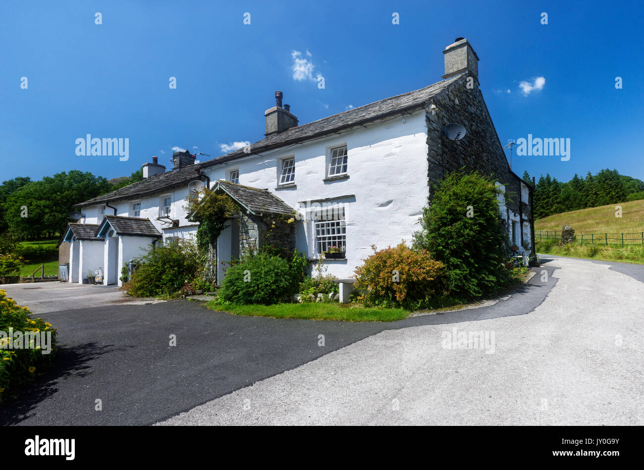 Whitewashed country cottage near Elterwater in the Langdale area of the English Lake District - Stock Image