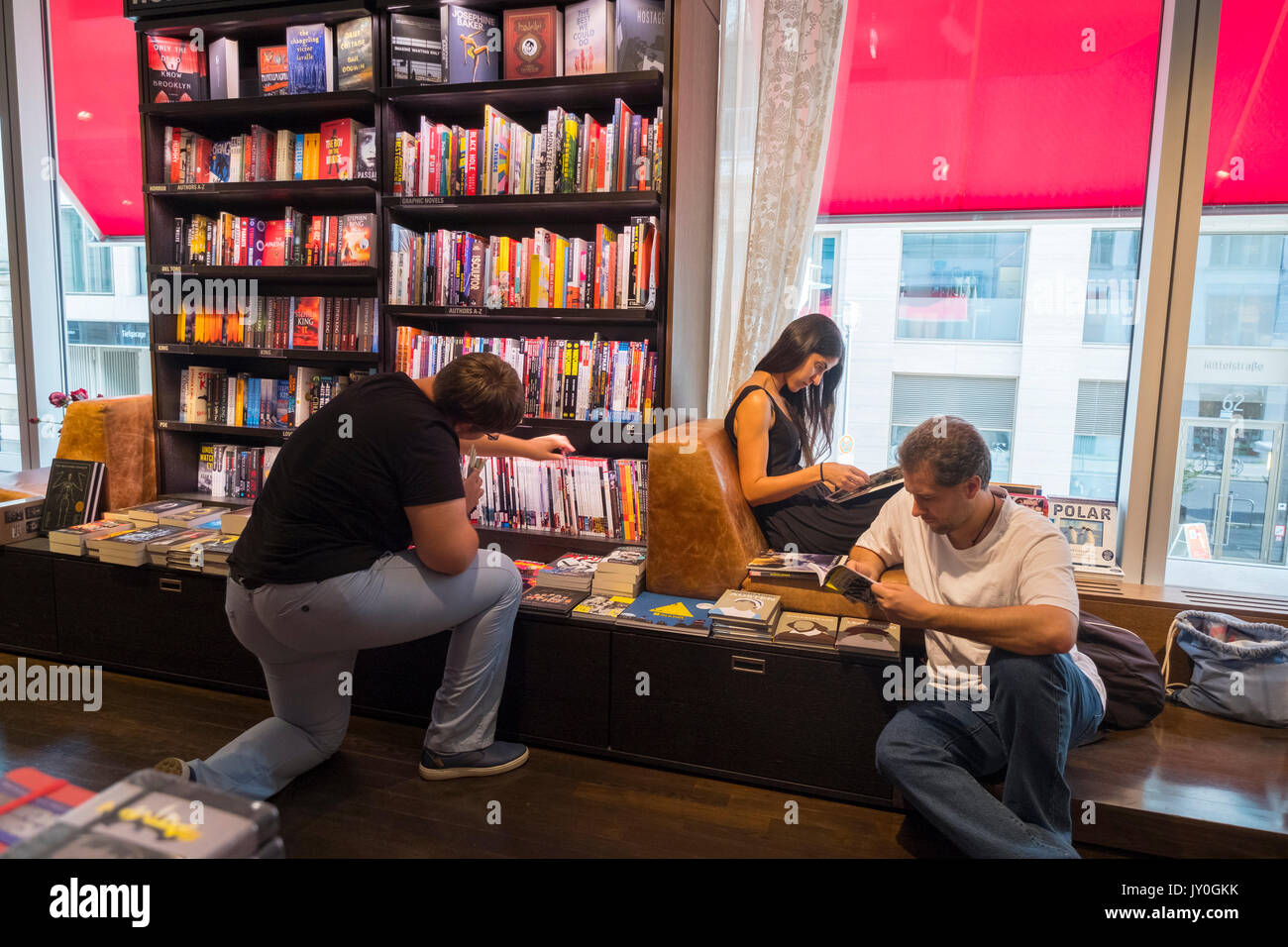 Interior of large bookstore and media shop Dussmann on Friedrichstrasse in Mitte, Berlin, Germany. - Stock Image