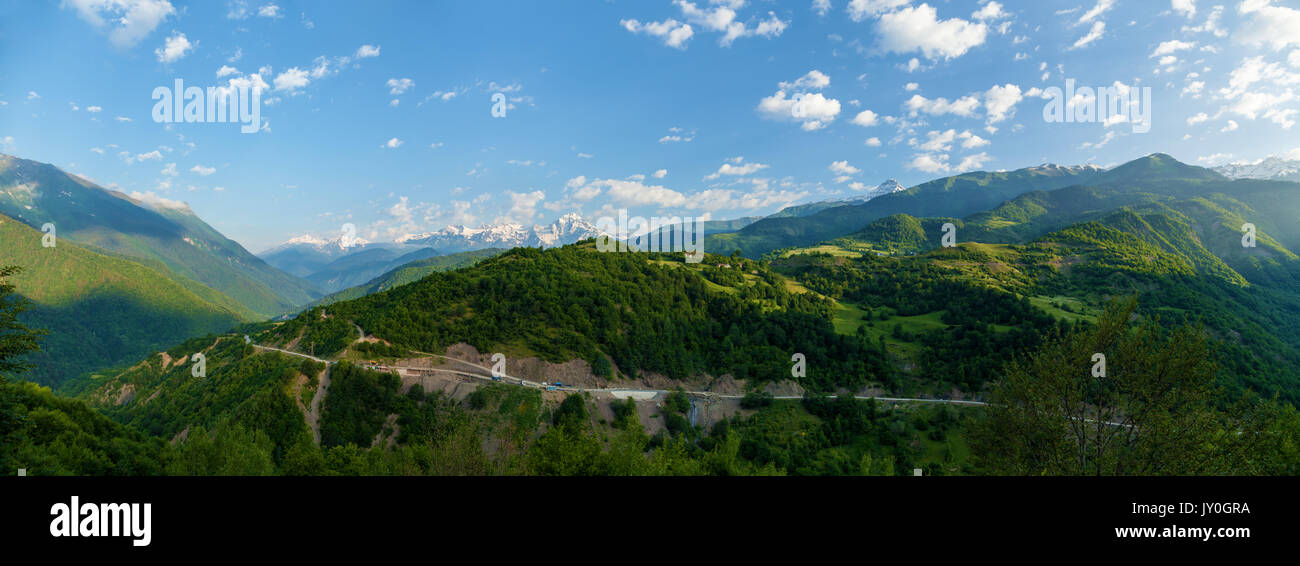 View of mountain peaks. Mountain road and mountains with clouds - Stock Image