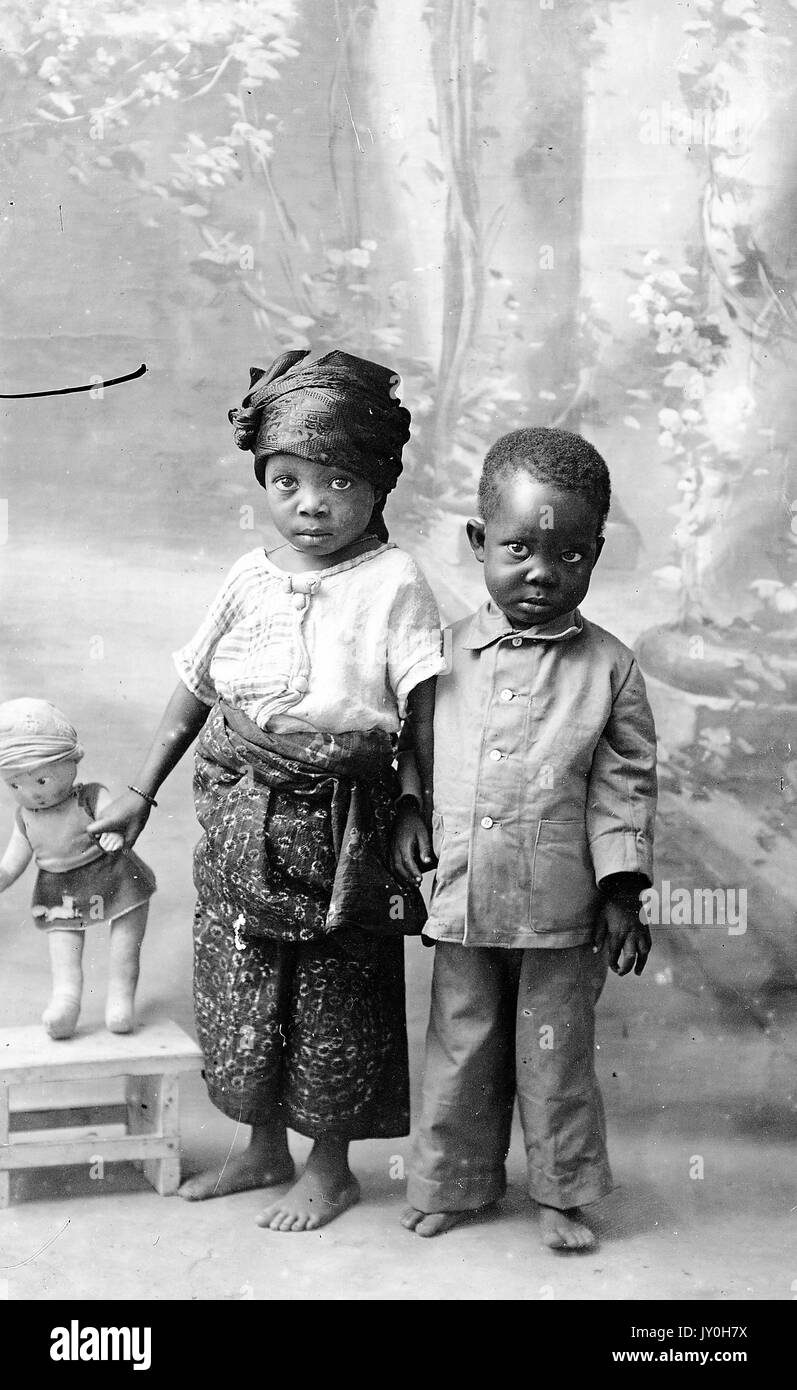 Full Length Standing Portrait Of Two African American Children Girl