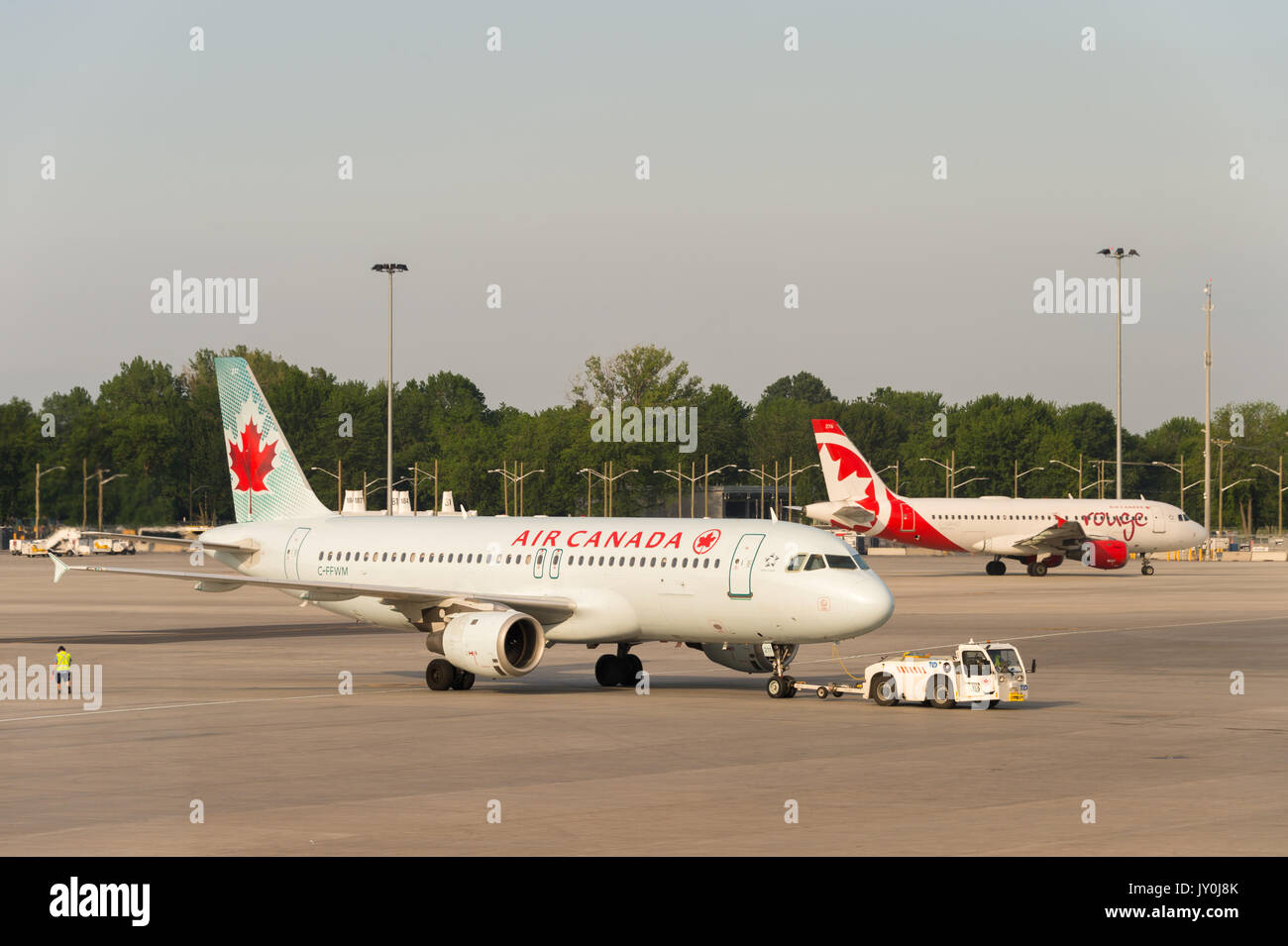 Air Canada commercial planes on the tarmac of Montreal Pierre Elliott Trudeau International Airport - Stock Image
