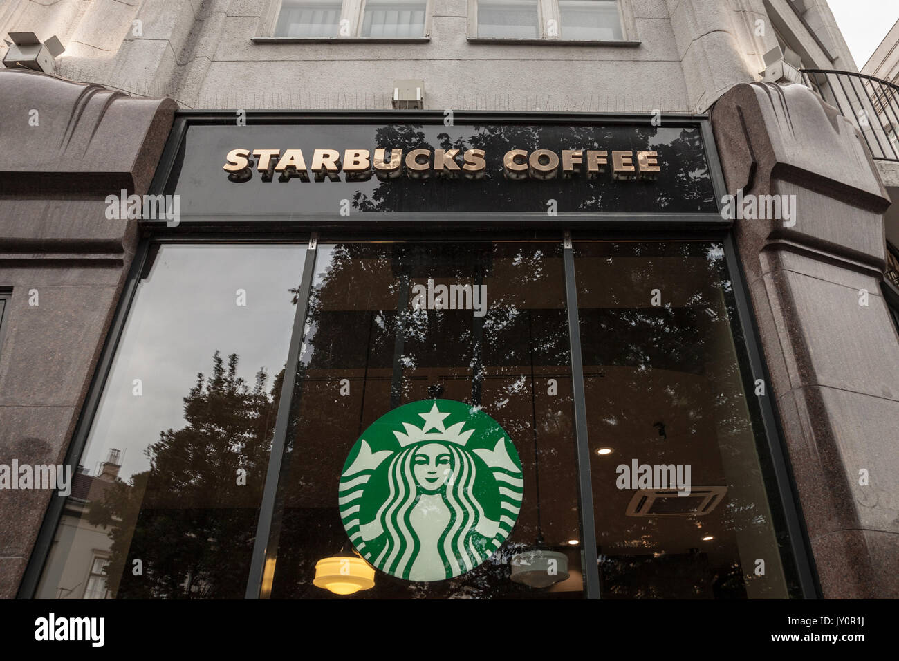 BUDAPEST, HUNGARY - AUGUST 11, 2017: Starbucks logo in front of a Starbucks coffeehouse in the city center of Budapest, capital city of Hungary  Pictu - Stock Image