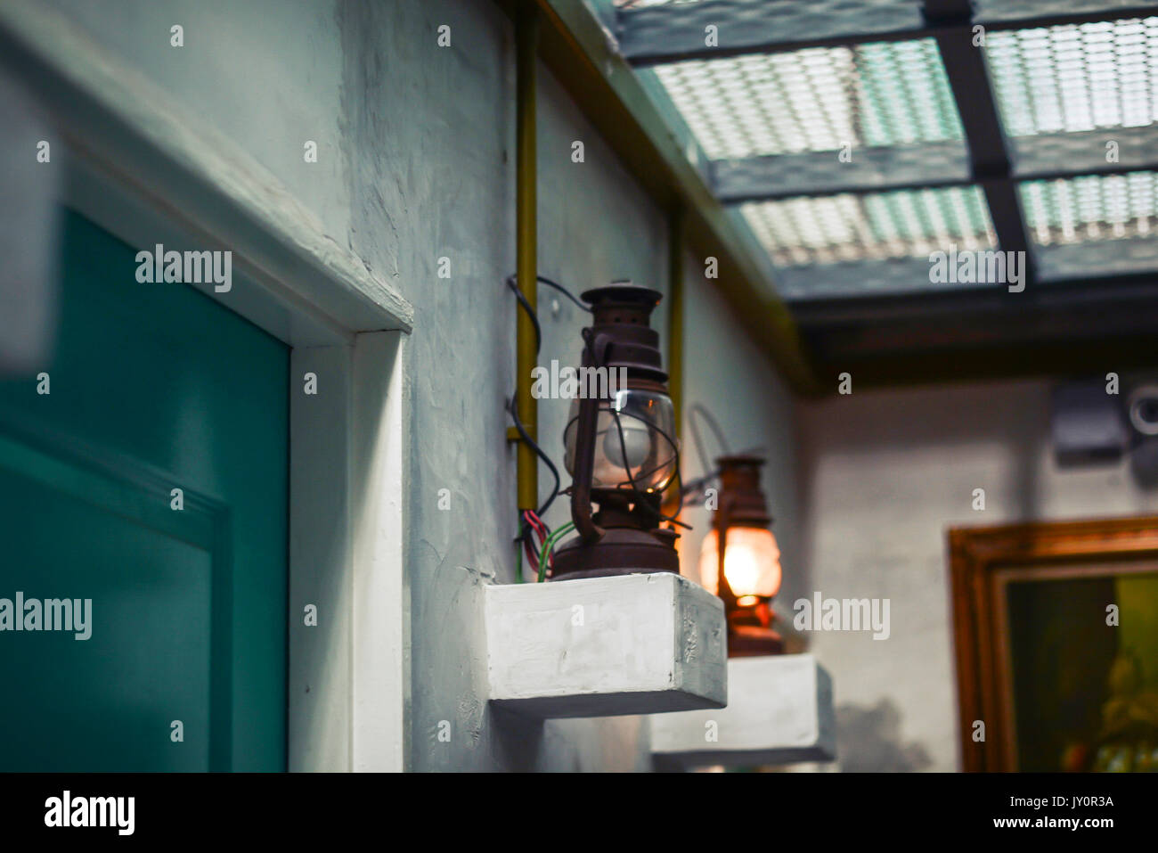 Classic vintage wall lamp in Hostel Stock Photo