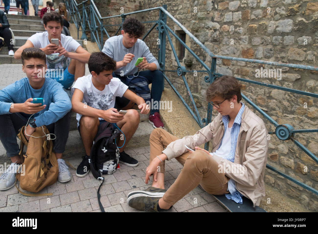 phone, kid, mobile, internet, technology, boy, smartphone, people, young, game, caucasian, person, gadget, fun, girl, playing, smart, using, online, c - Stock Image