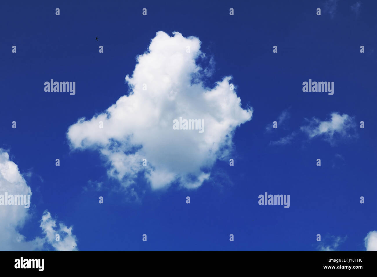 Cloud Against The Blue Sky - Stock Image