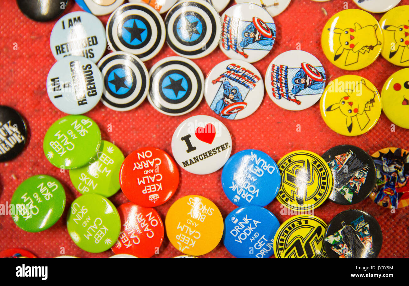 Afflecks Palace in Manchester City Centre for alternative music and clothes shopping. A Collection of Badges with one saying 'I Love Manchester'. Phot - Stock Image