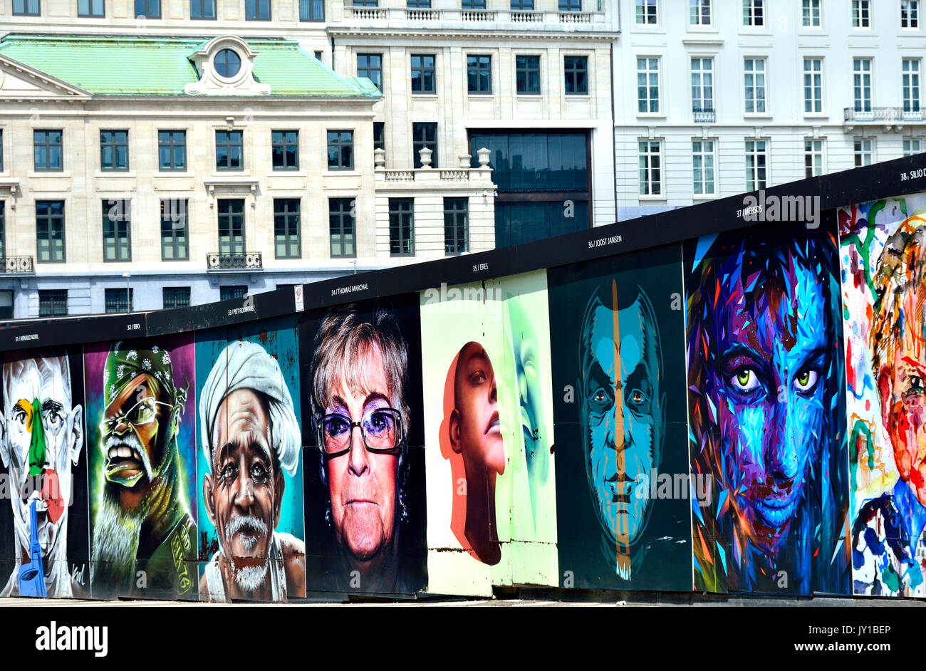 Brussels, Belgium. Street art in Rue Ravenstein - 'Interfaces': 40 portraits by 40 artists on temporary walls around building works. Initiative by ... - Stock Image