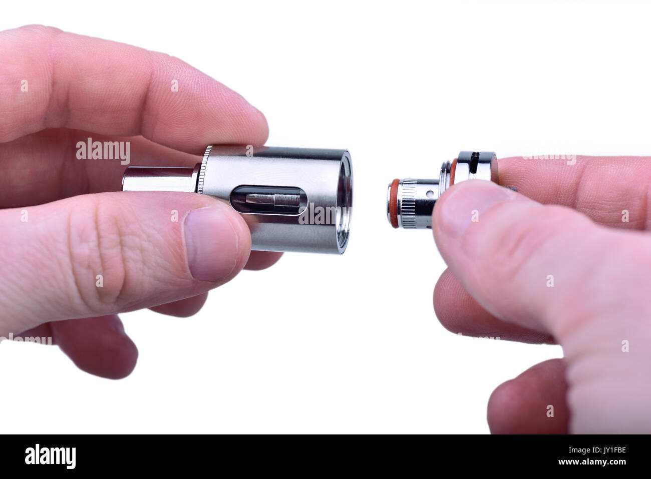 Screwing the coil in sub-ohm tank for e-cig mod - Stock Image