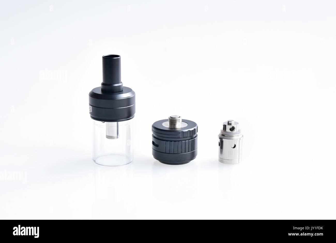Disassembled e-cig atomizer isolated on white background - Stock Image