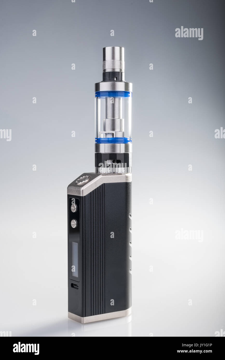 E-cig box mod on gray and white background - Stock Image