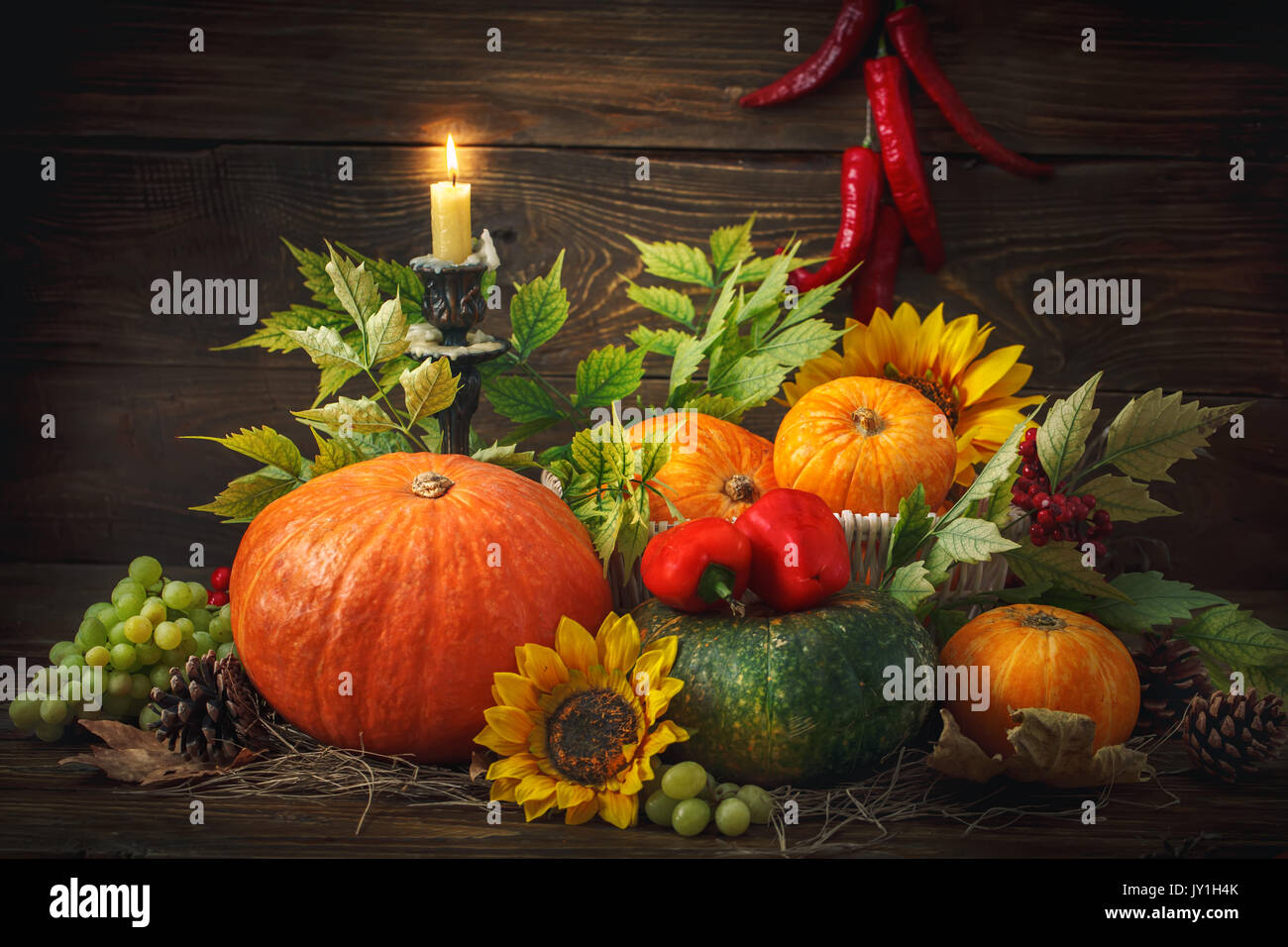 Happy Thanksgiving Day background, wooden table, decorated with vegetables, fruits and autumn leaves. Autumn background. - Stock Image