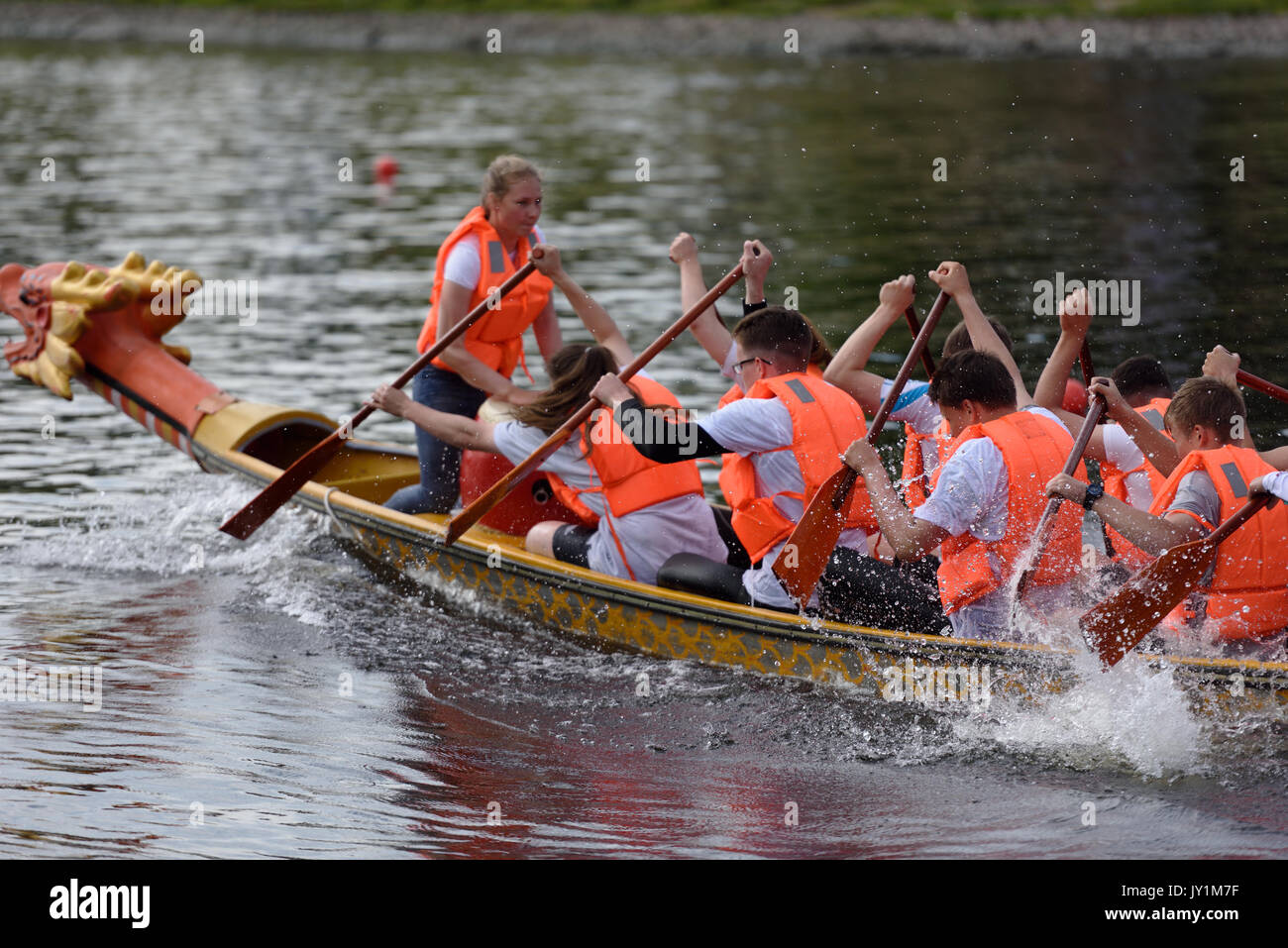 St. Petersburg, Russia - June 12, 2015: Competitions of Dragon boats during the Golden Blades Regatta. This kind of competitions make the race accessi - Stock Image