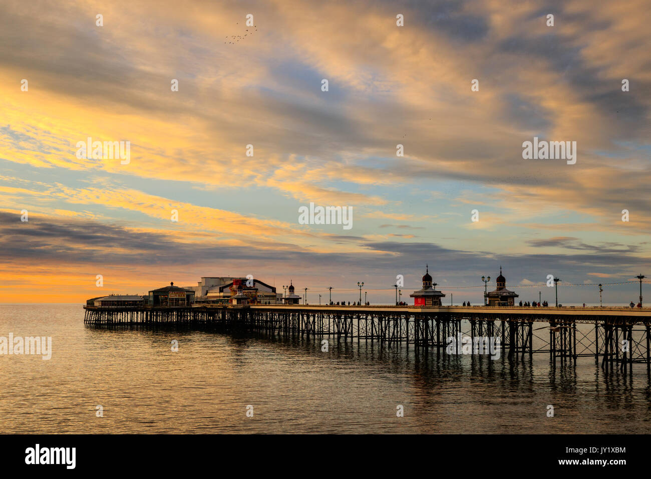 Blackpool north pier at sunset in winter - Stock Image