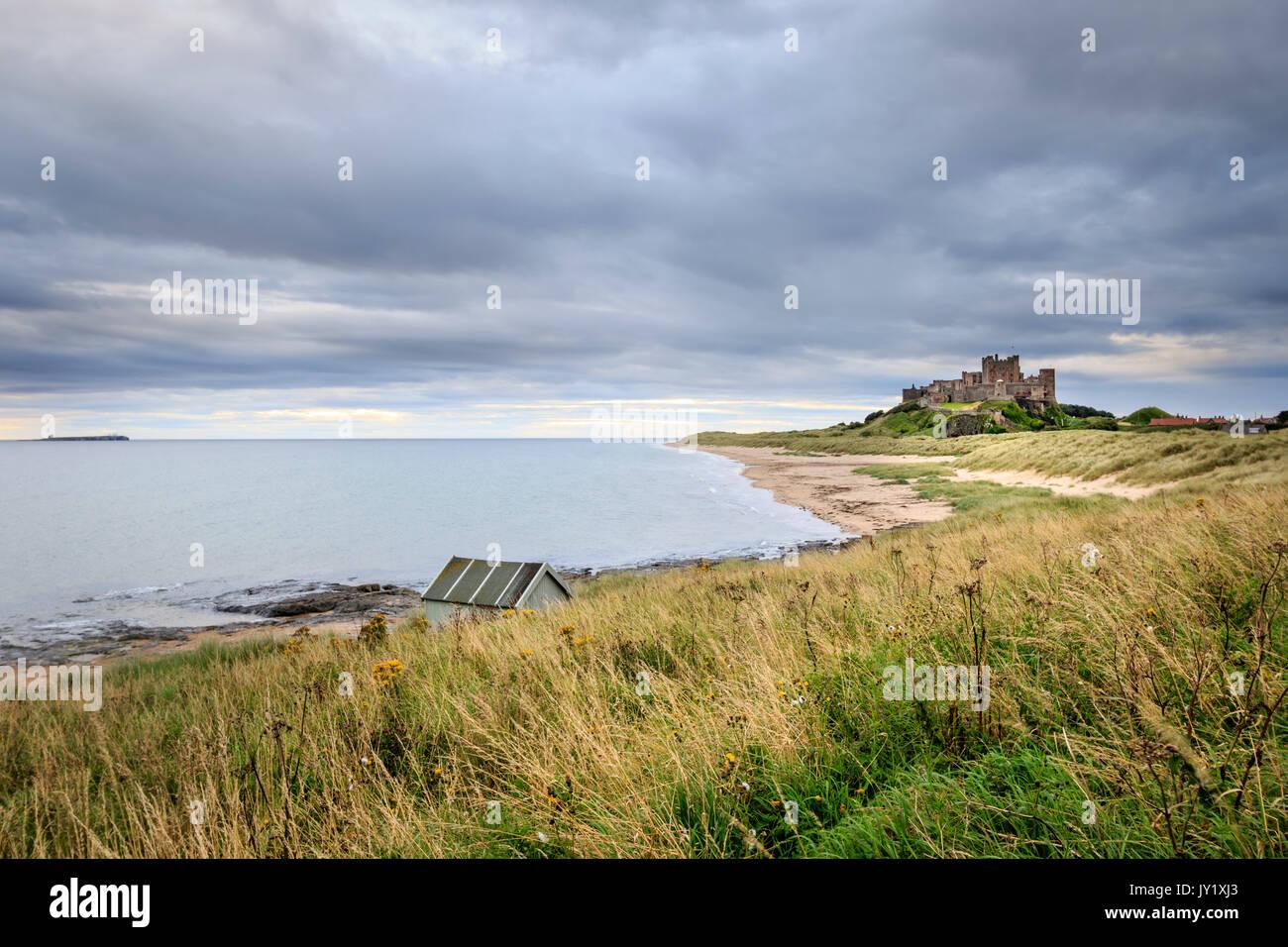 Bamburgh castle sunrise on the Northumberland coastline - Stock Image