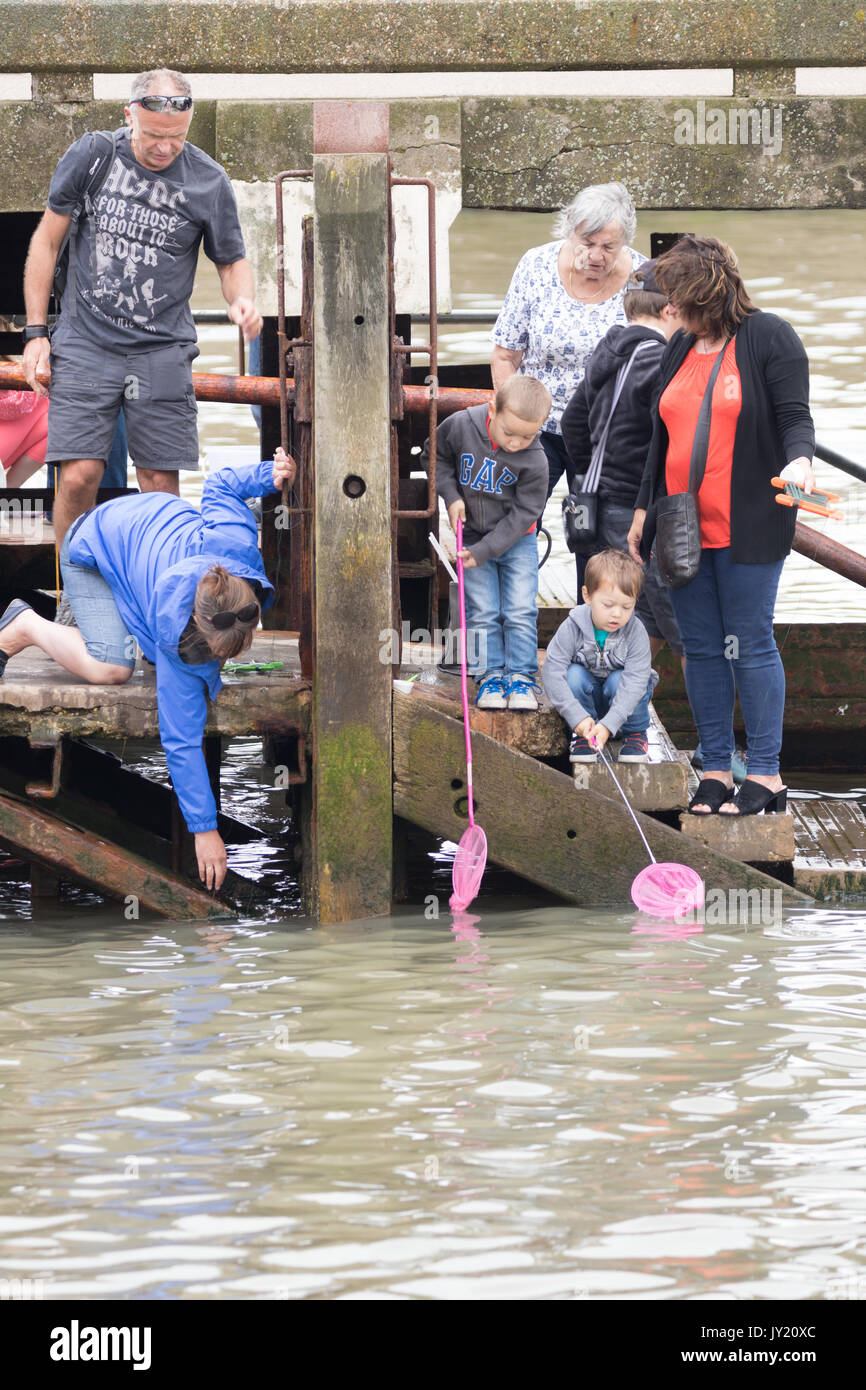 Holidaymakers fishing in Bridlington Harbour - Stock Image