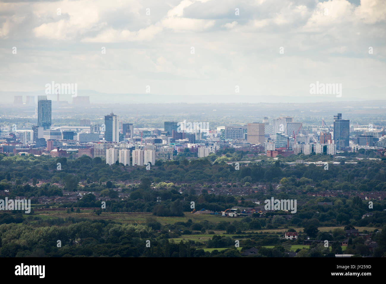 A view of Manchester City Centre from the vantage point of Hartshead Pike, Mossley, in Saddleworth, UK - Stock Image