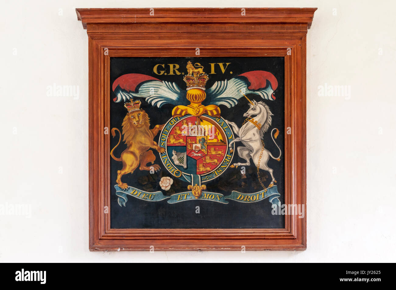The Royal Arms of George IV on the west wall of St Mary's church,East Guldeford on Romney Marsh. - Stock Image