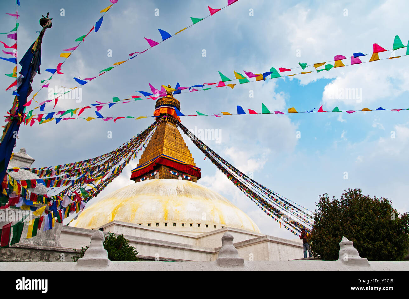 Bodhnath Stupa Temple and praying flag. Boudhanath Stupa (or Bodnath Stupa) is the largest stupa in Nepal and the holiest Tibetan Buddhist temple outs - Stock Image