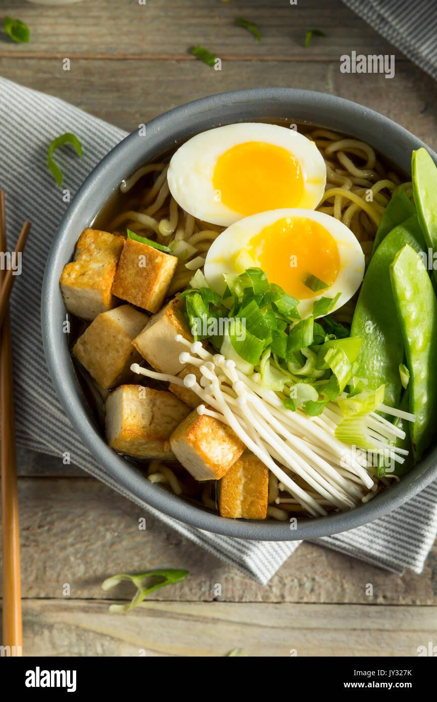 Homemade Japanese Vegan Tofu Ramen Noodles with Egg and Mushrooms Stock Photo