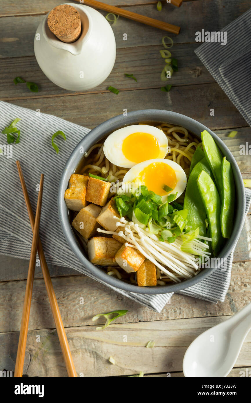 Homemade Japanese Vegan Tofu Ramen Noodles with Egg and Mushrooms - Stock Image