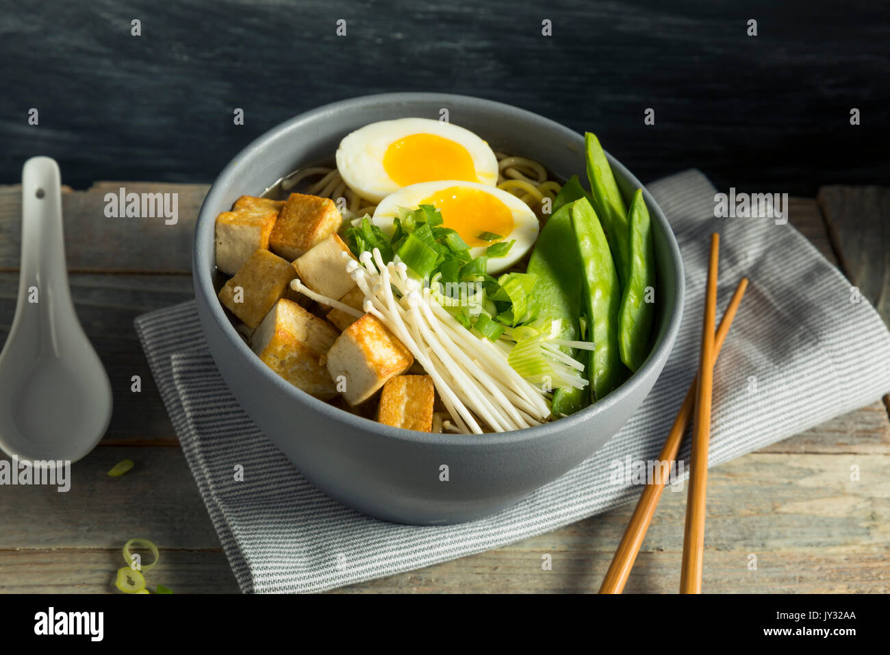 Homemade Japanese Vegan Tofu Ramen Noodles with Egg and Mushrooms - Stock Image