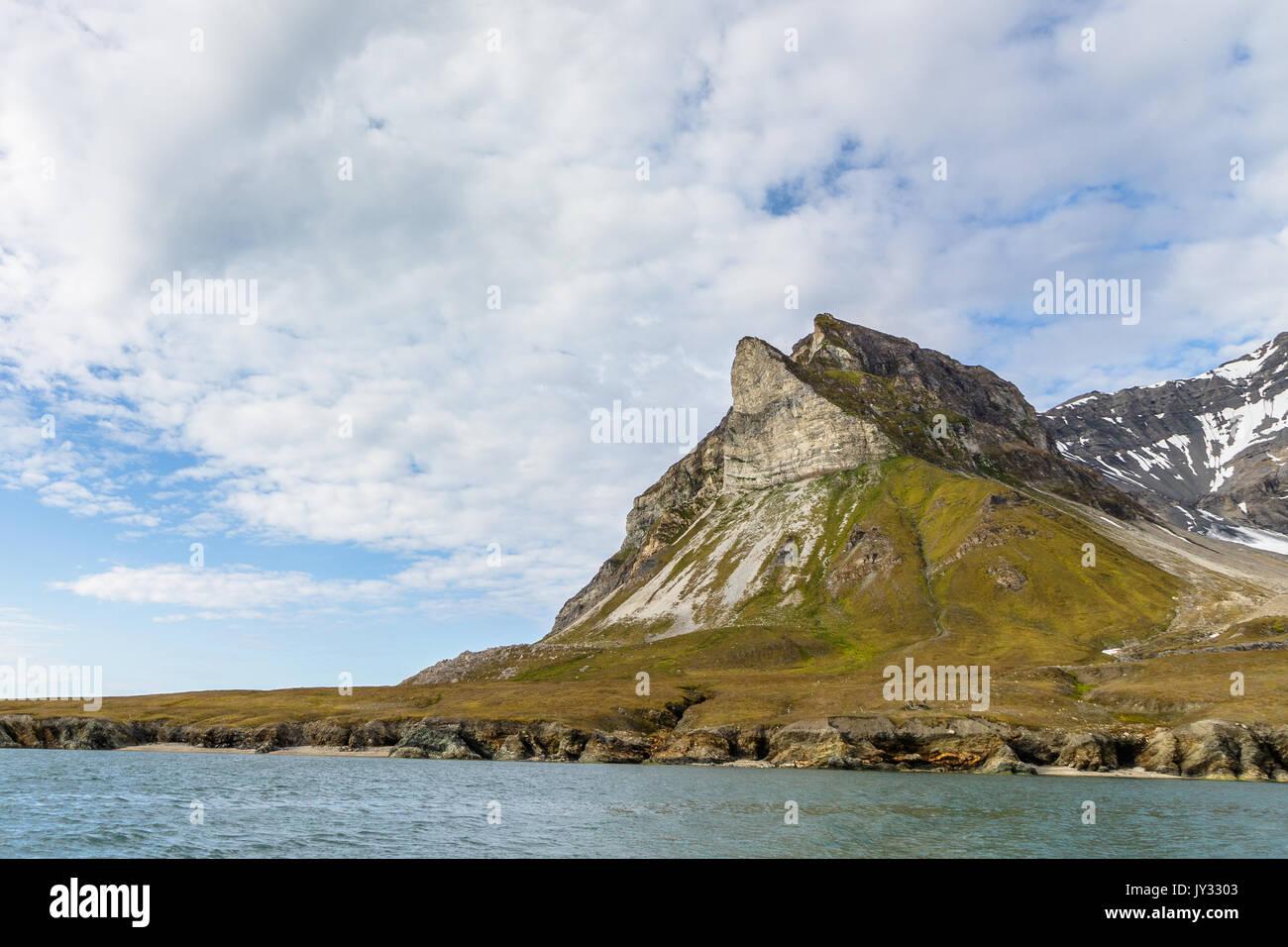 Alkehornet aka Alkhornet aka Alkepynten, bird mountain in Svalbard, Norway Stock Photo