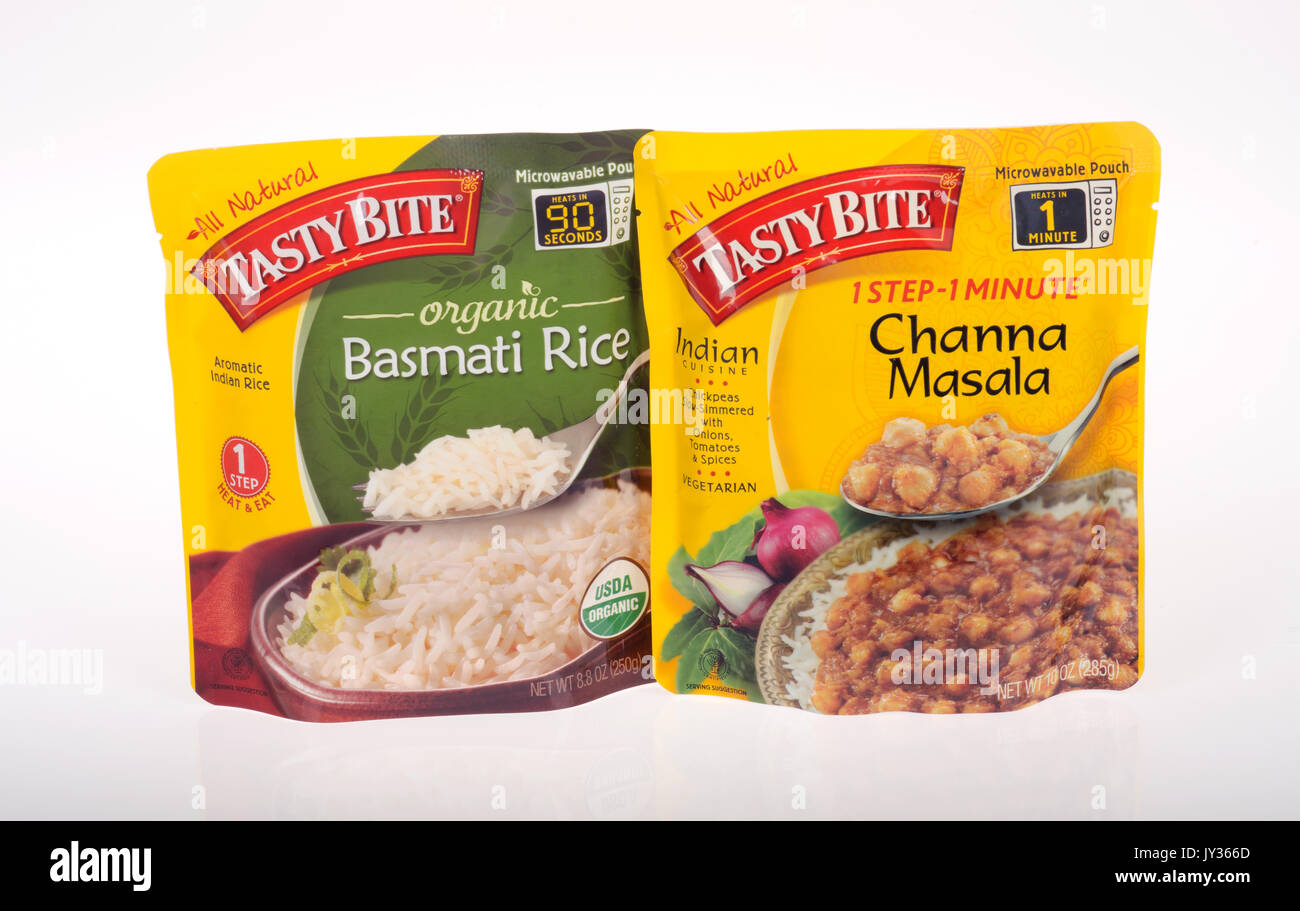 Unopened Packages of Tasty Bite prepared foods organic basmati rice and channa marsala on white background. USA Stock Photo