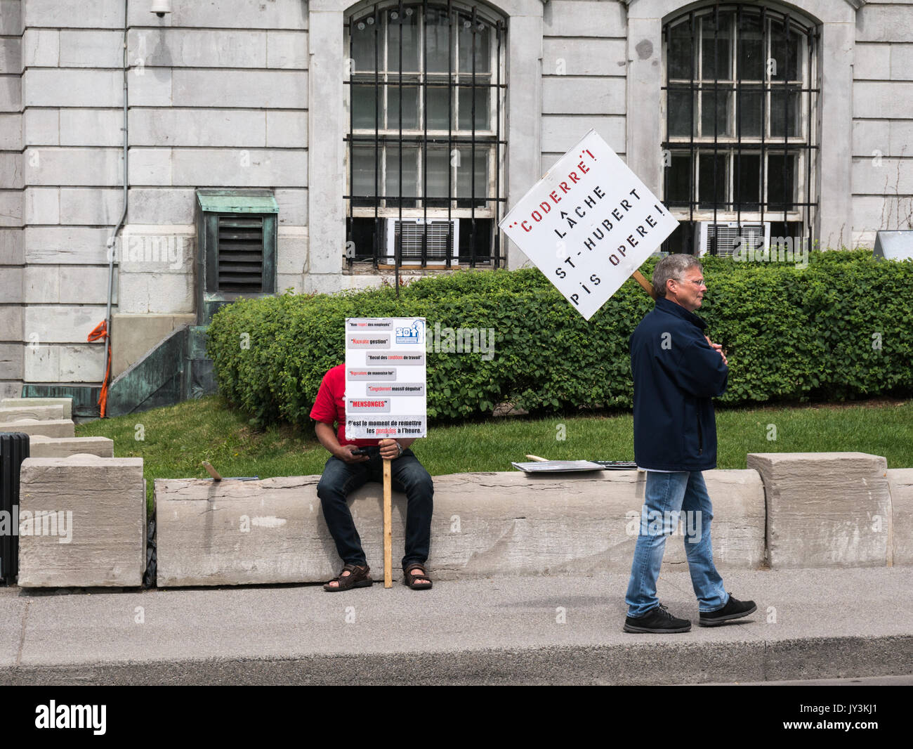 Workers protesting employer's policies. - Stock Image