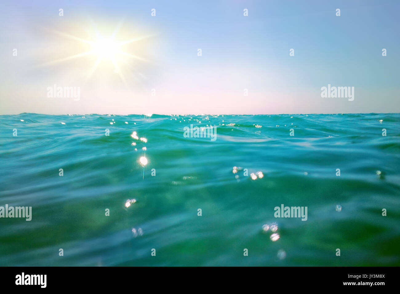small commotion on surface sea tropical sun hot - Stock Image
