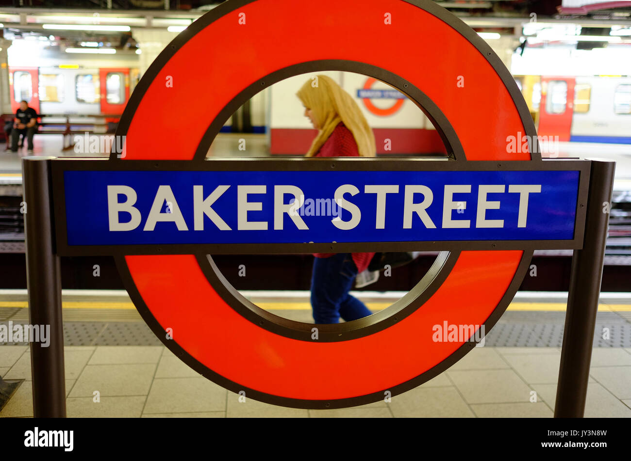 A British Muslim woman travels through Baker Street Station, London - Stock Image