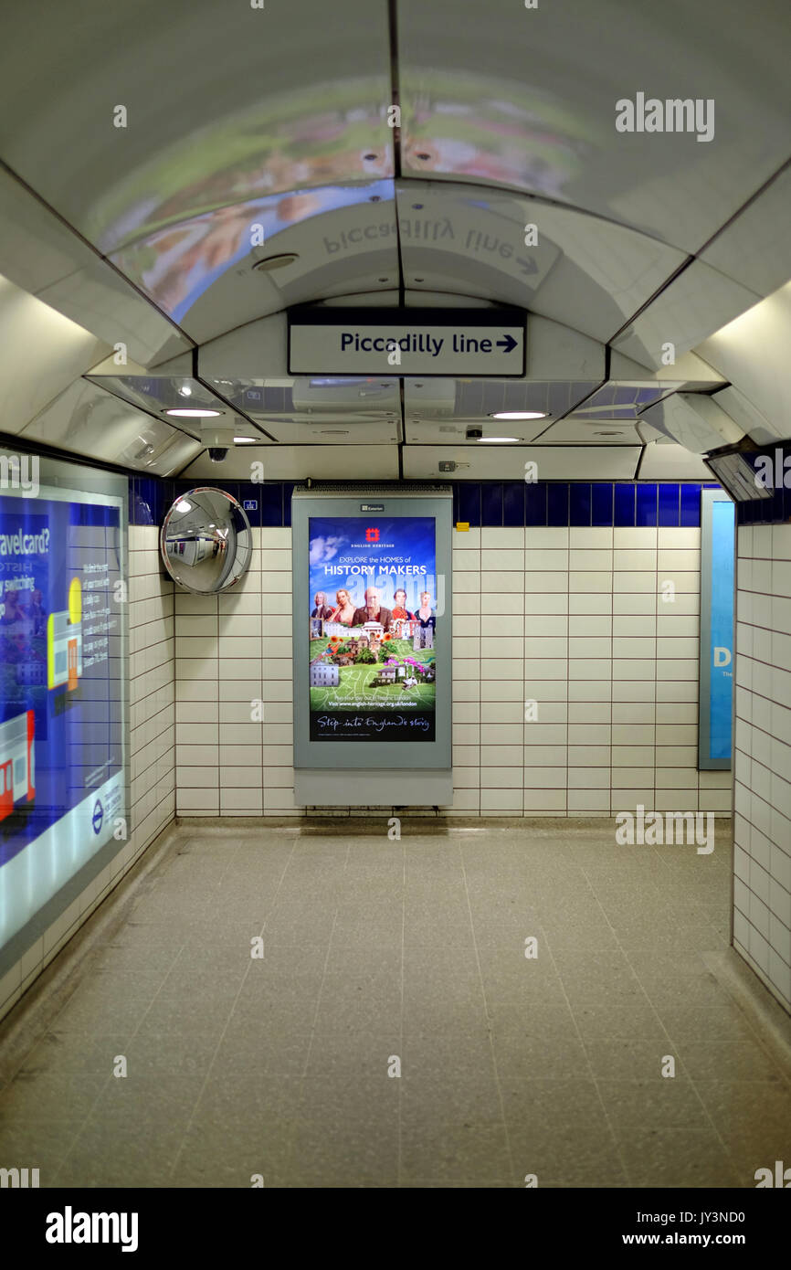 The tunnel leading to a the trains in Leicester Square tube station - Stock Image