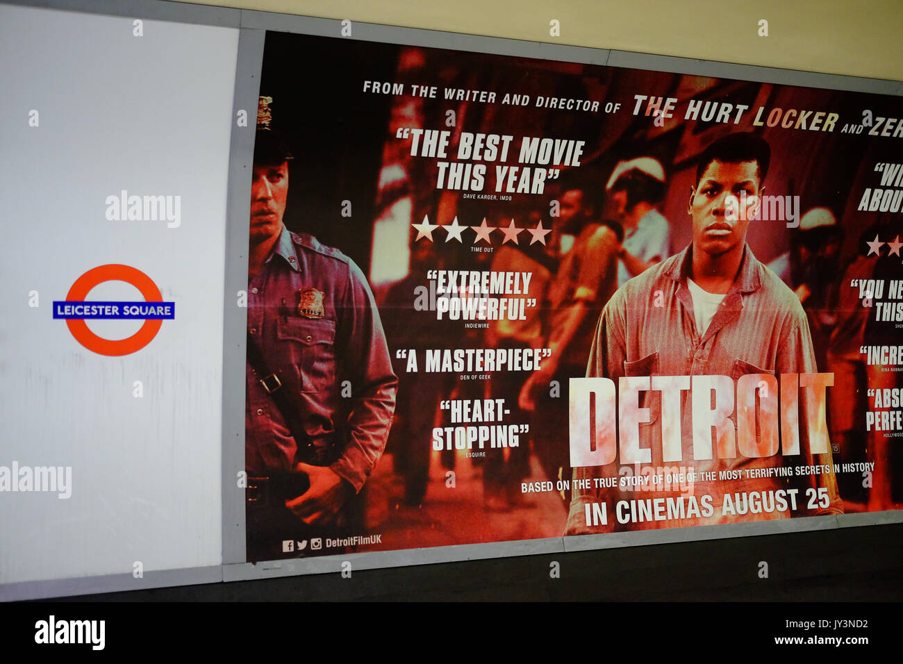A movie poster for the film Detroit on the platform of Leicester Square underground station in the West End of London - Stock Image