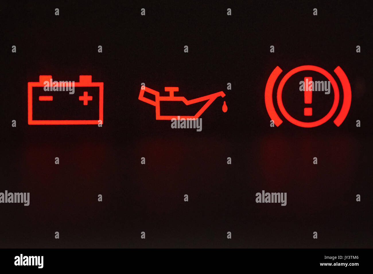 Macro Of Error Signs In Car Red Icons Of Battery Oil And Hand