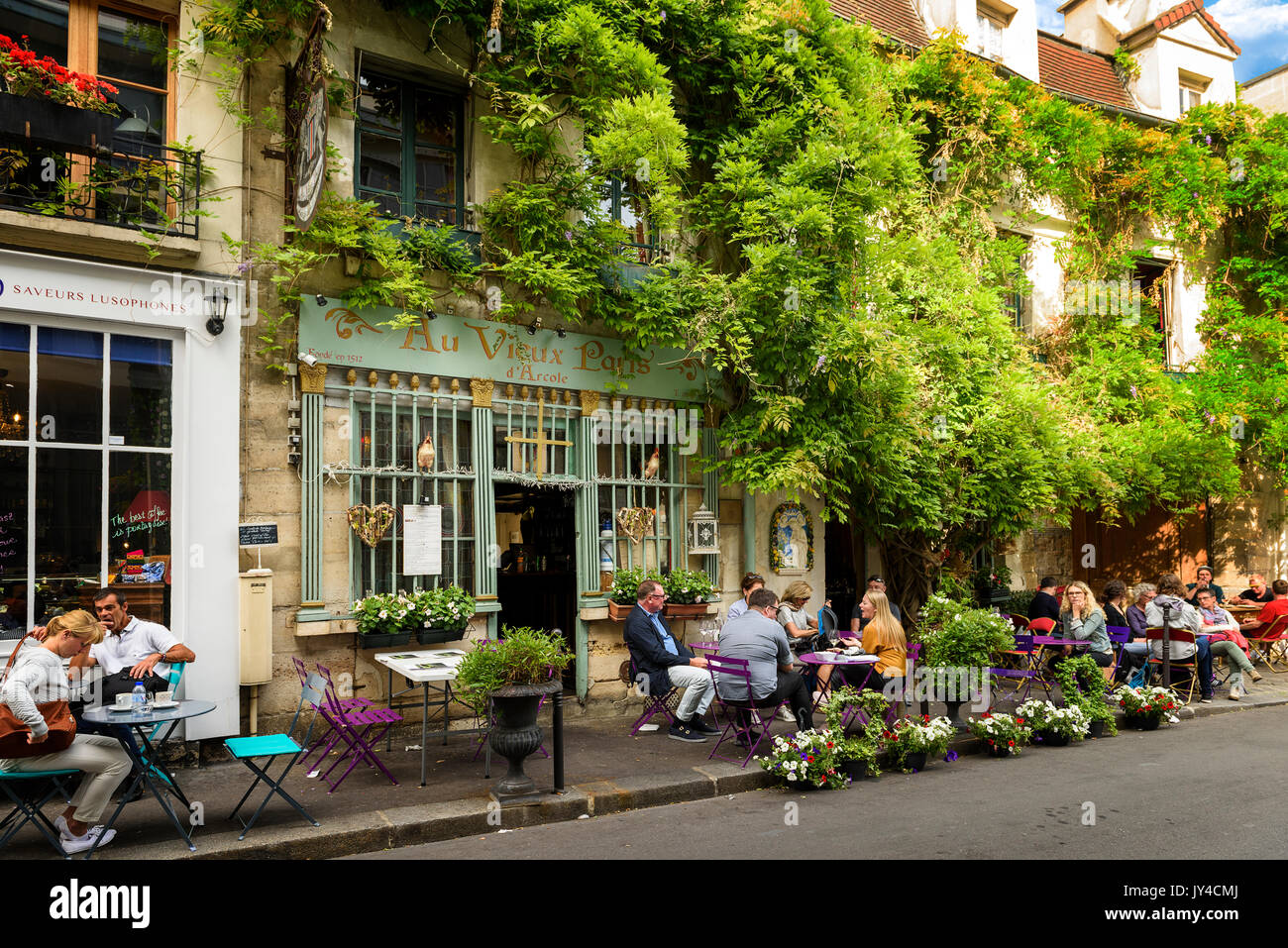 Paris, France, June 04, 2017 : Famous style of life in Paris, France with bistrrots and people on terraces. Here, this is 'The old Paris' traditional  - Stock Image