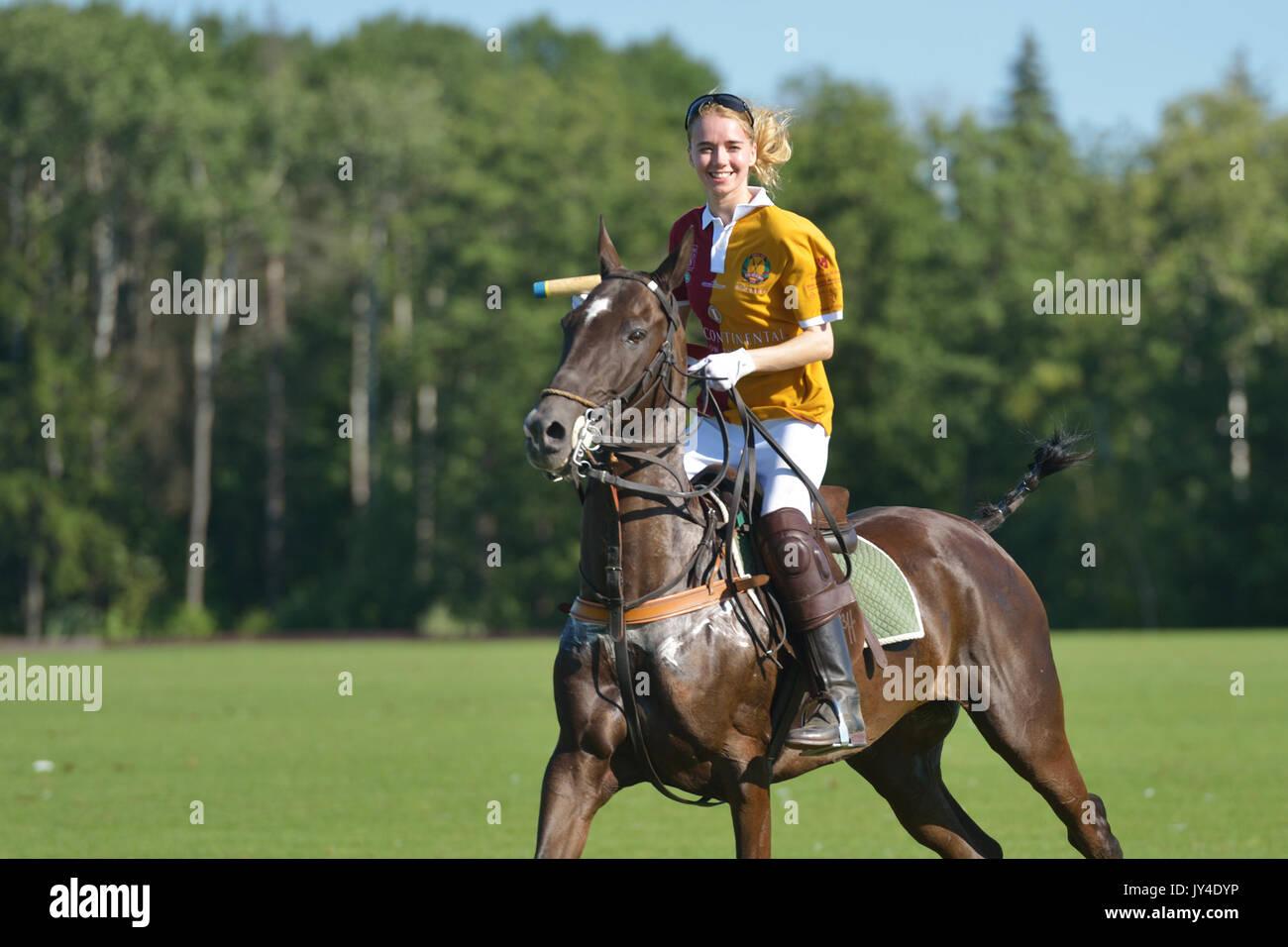 Tseleevo, Moscow region, Russia - July 26, 2014: Aliona Chekhova of Tseleevo Polo club after the match against the Oxbridge polo team during the Briti - Stock Image