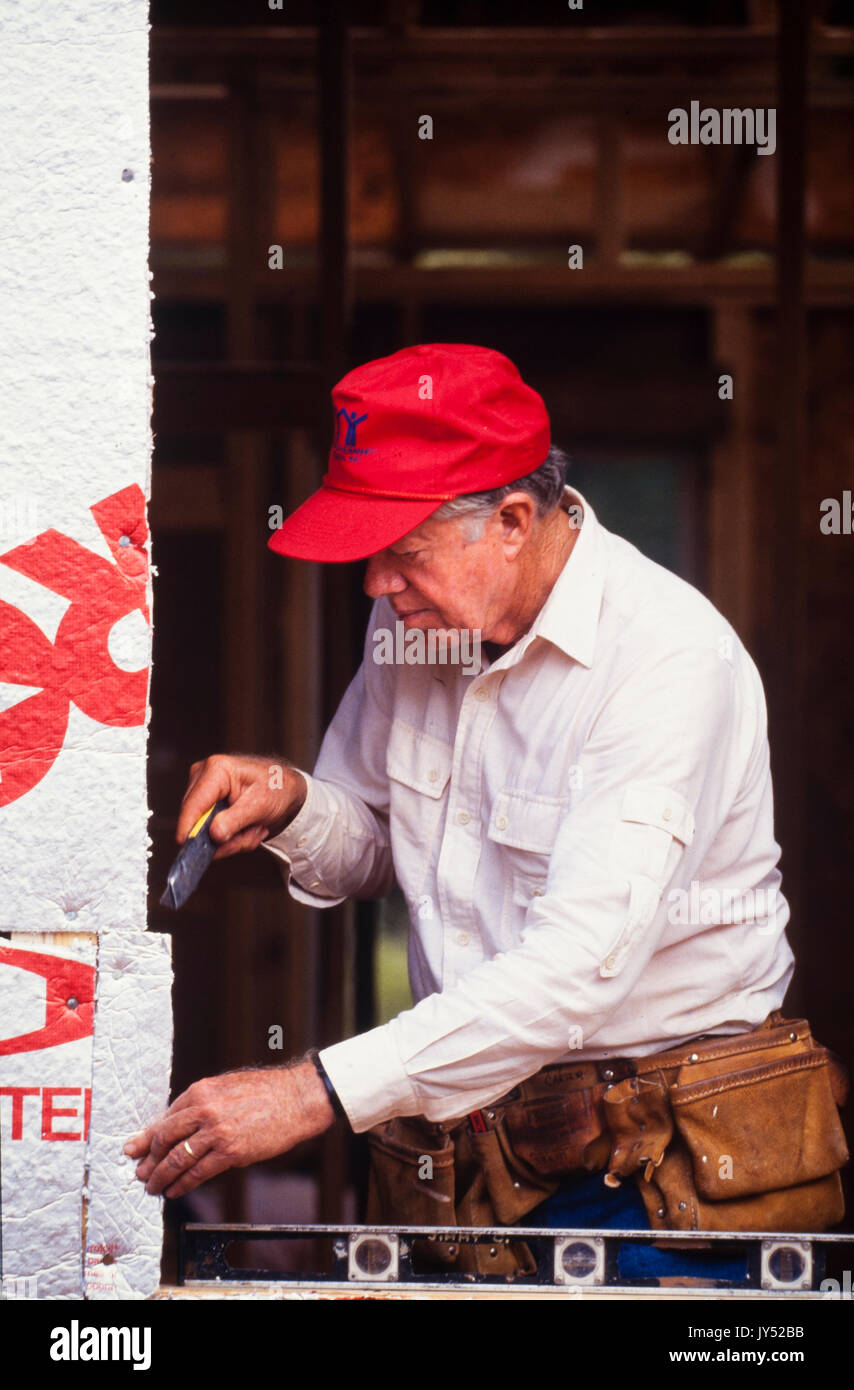 President Jimmy Carter volunteers at a Habitat for Humanity project in Atlanta, GA in 1991. - Stock Image