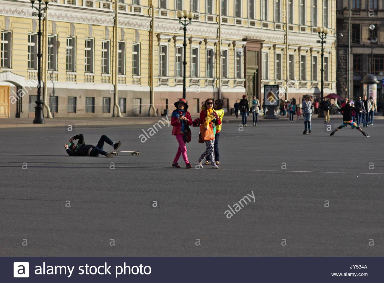 Fallen skater and tourists on palace square Stock Photo