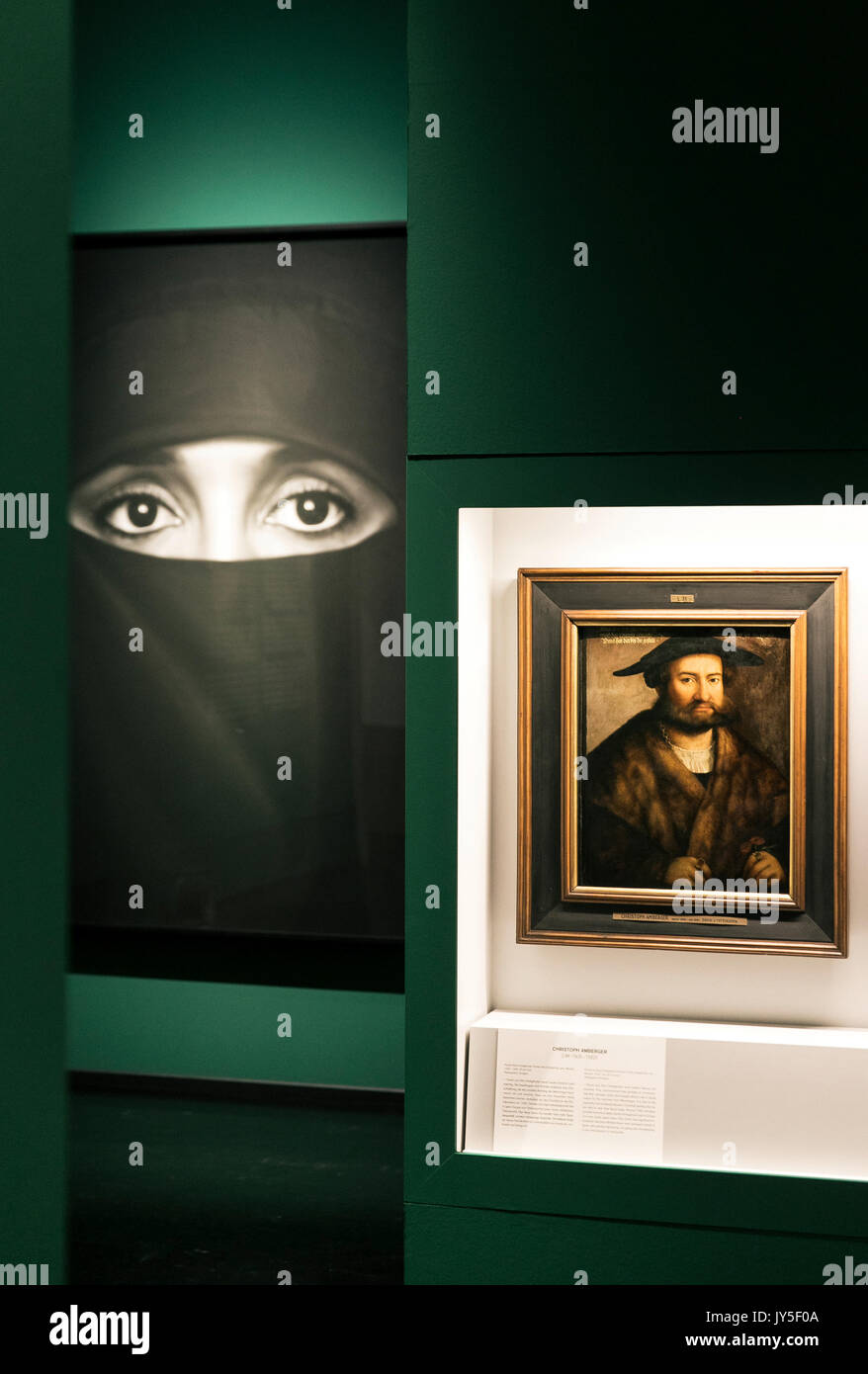 Dresden, Germany. 17th Aug, 2017. The pictures 'Untitled (Hanane in a Burka)' (2010) by Robert Longo (L) and the portrait 'David Dettigkhofer' (1577) by Christoph Amberger photographed in an exhibition room of the new exhibition 'The face. A search for clues' ('Das Gesicht. Eine Spurensuche') in the German Hygiene Museum in Dresden, Germany, 17 August 2017. The exhibition takes place between 19 August 2017 and 25 February 2018. Photo: Oliver Killig/dpa-Zentralbild/dpa/Alamy Live News - Stock Image