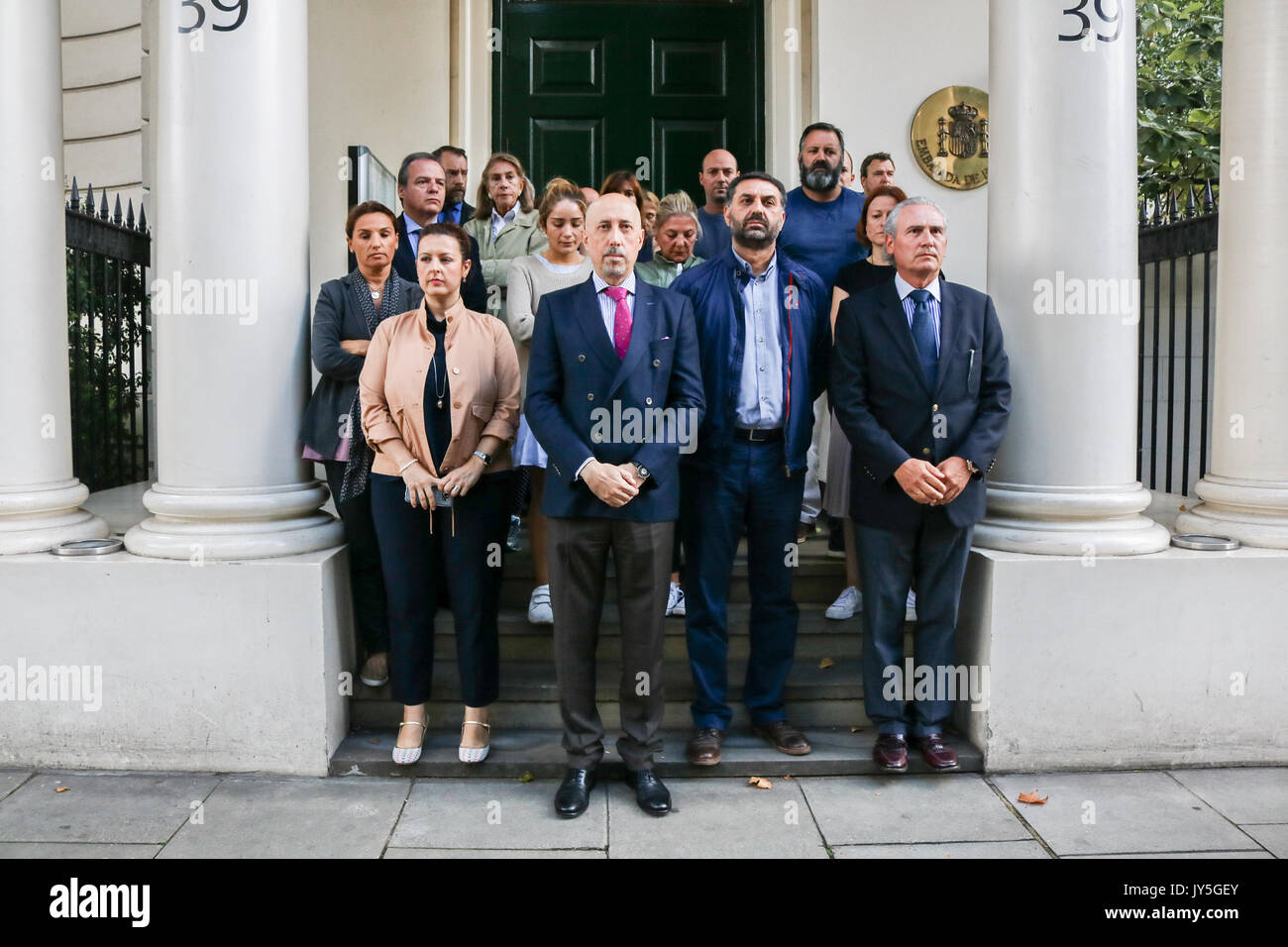 London UK. 18th August 2017. Spanish Embassy staff led by Jose Maria Fernandez Lopez de Turiso (Deputy Head of Mission) held a one minute silence  outside the Spanish embassy in  London for the victims of the Barcelona terror attacks Credit: amer ghazzal/Alamy Live News - Stock Image