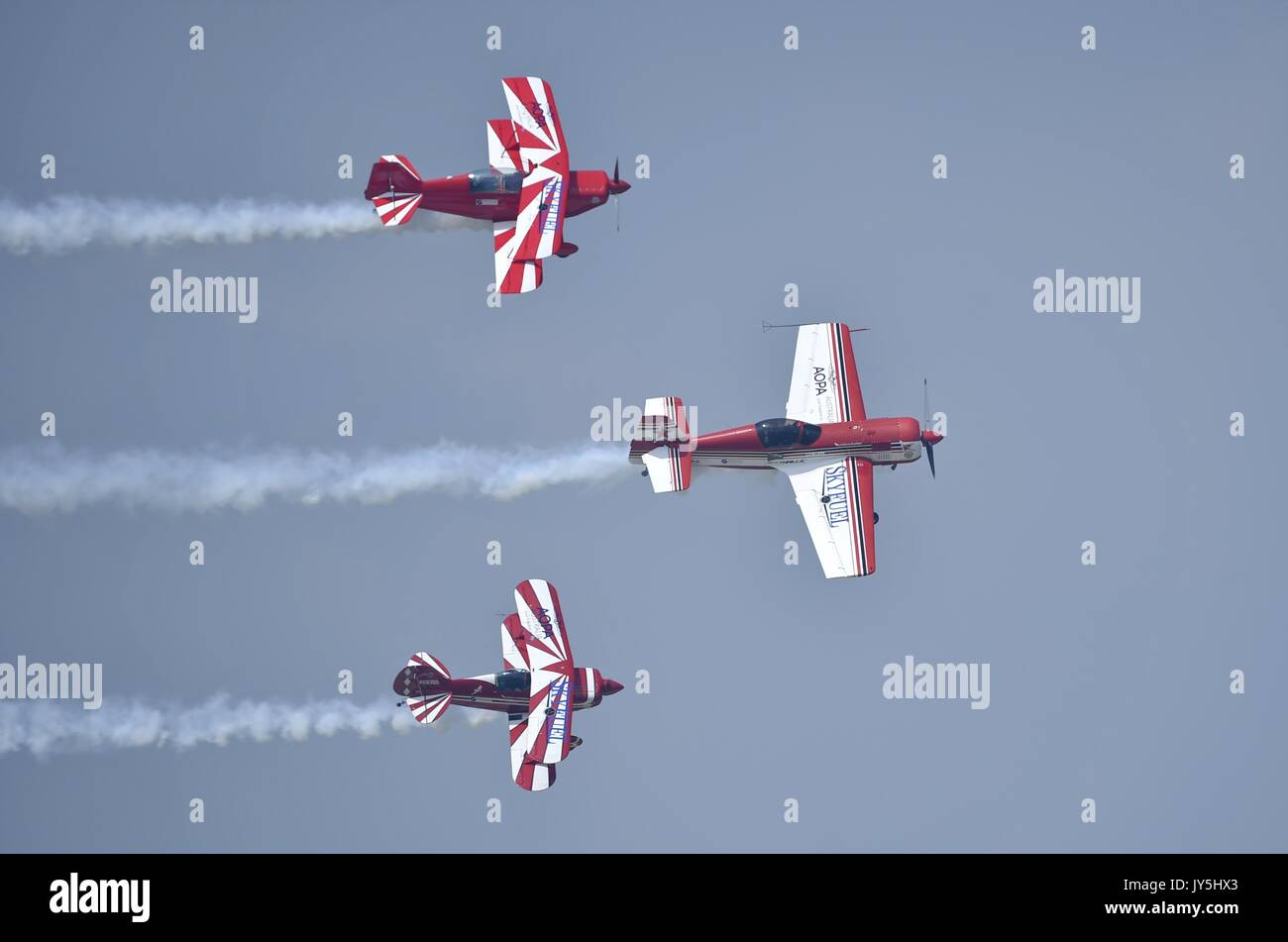 Shenyang. 18th Aug, 2017. Squadron members perform aerobatic flight during the 6th Faku Flight Conference in Shenyang, Stock Photo