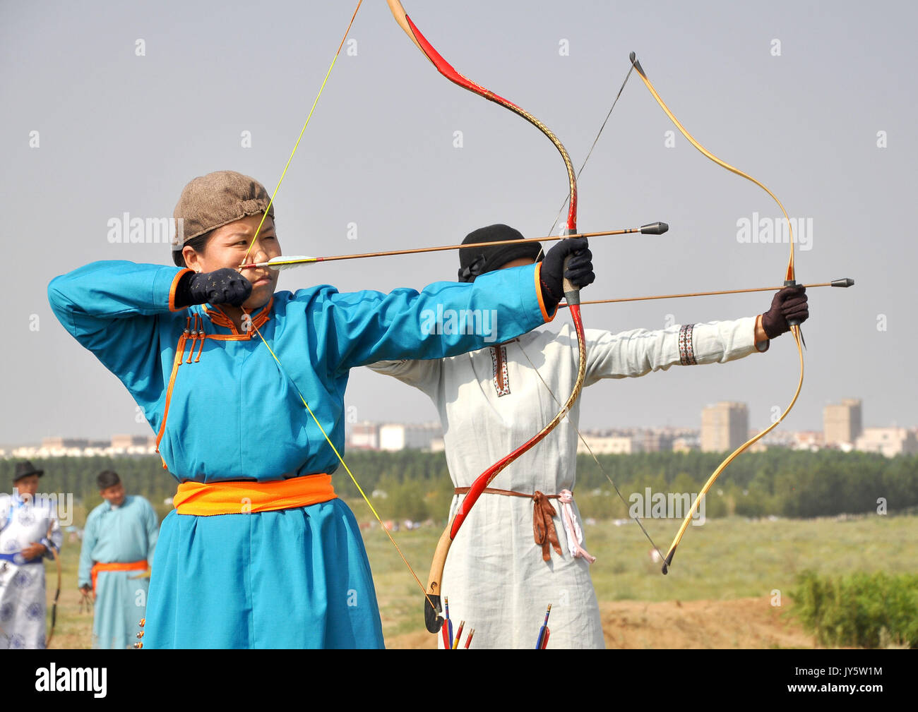 Bayan Nur, China's Inner Mongolia Autonomous Region. 18th Aug, 2017. Herdsmen take part in an archery contest during Stock Photo